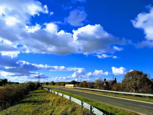 blue sky dramatic sky road country road clouds