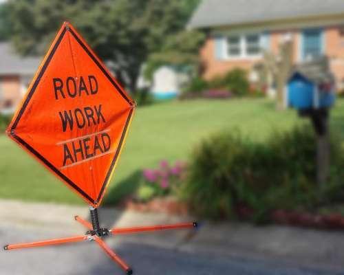 house road work sign mailbox yard