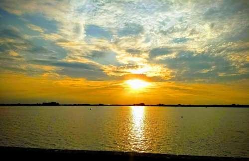 sunset reservoir lake reflections golden sunset
