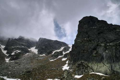 rocks mountain peak high