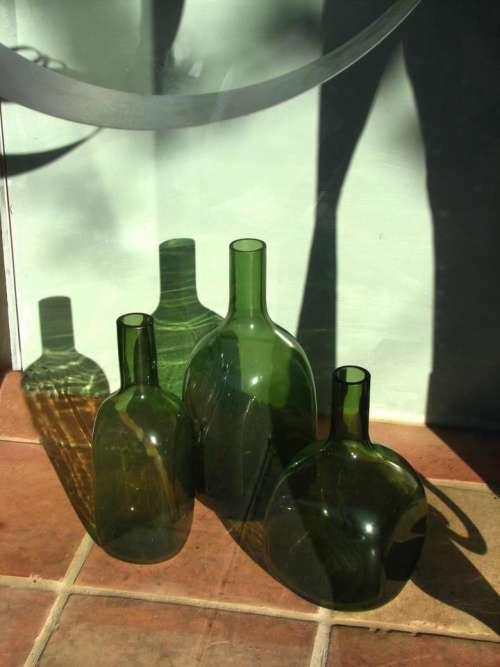 bottles green glass still life shadows