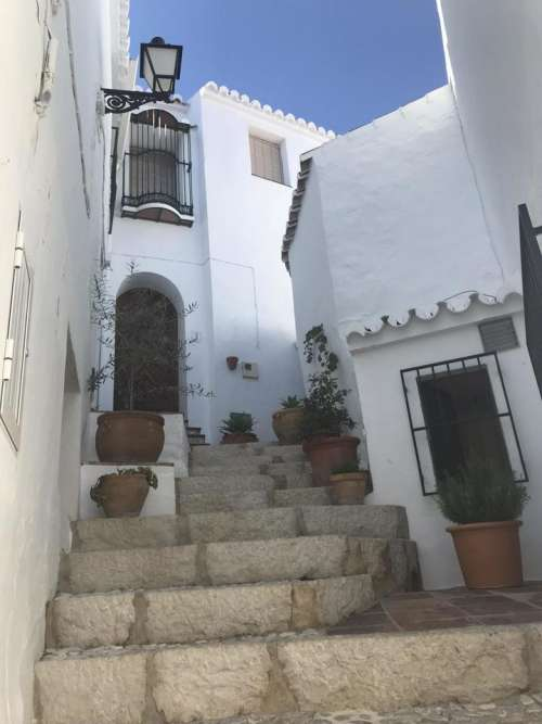 Spain white washed village Frigliana Costa del Sol stairs