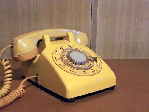 telephone phone landline rotary phone yellow