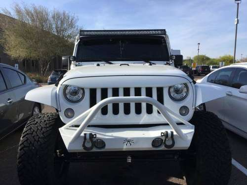 angry troll car white jeep