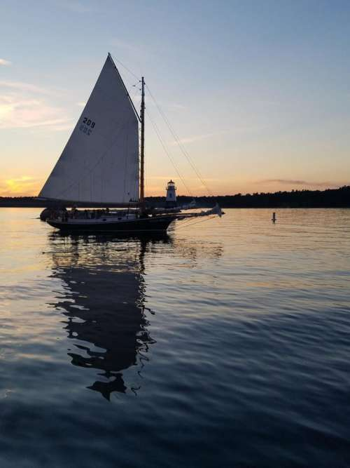Sailing sailboat sunset lake water