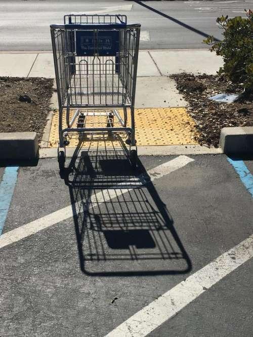 shopping cart cast shadow street parking lot