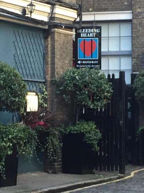 restaurant Bleeding Heart sign trees shrubs