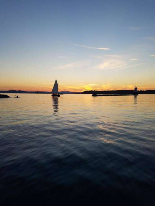 Lake Champlian sunset sailboat sailing lake