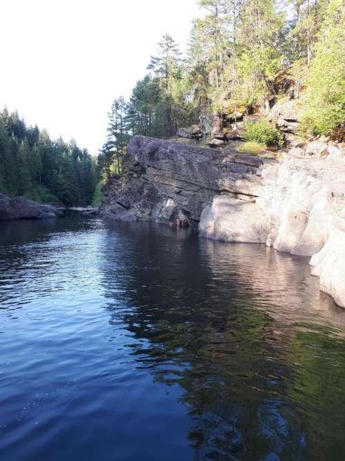 lake river rocks wilderness nature