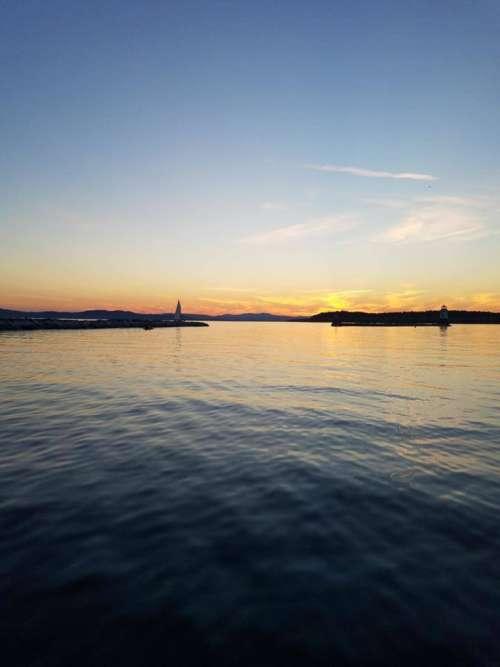 Sunset lake Champlian water