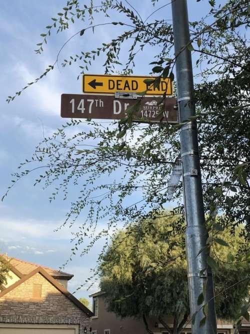 street sign dead end street street pole pole