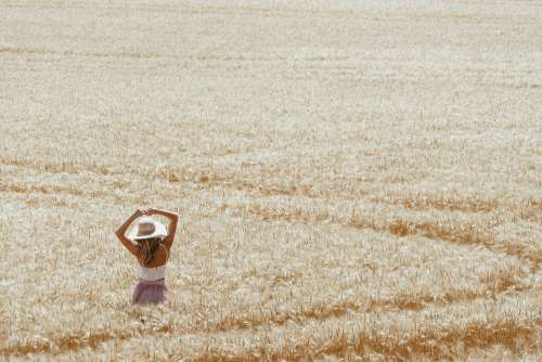 Beautiful Woman in Wheat Field