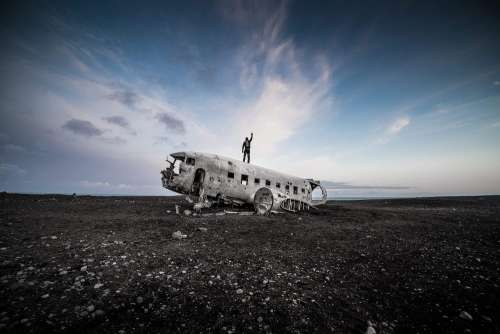 Man Standing on Top of the Iceland Famous Plane Wreckage