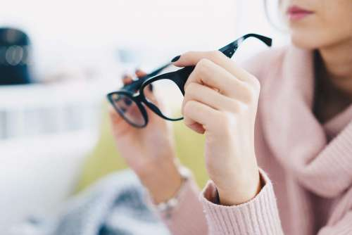 Woman Trying Eyeglasses in Optical Store