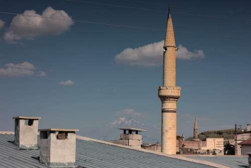Erciyes Cami Village Minaret Clouds Cappadocia