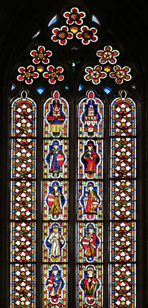 stained glass window with saints
