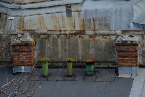 Old Chimneys on a Building Rooftop