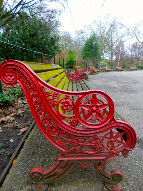 red bench ornate iron park