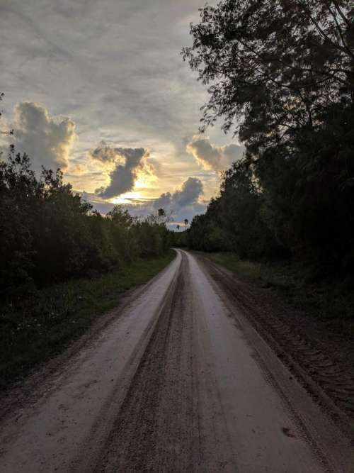 road curve sky sunset hard pack