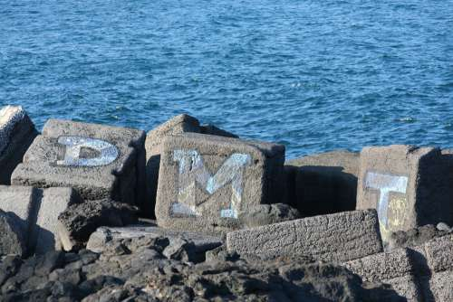 Graffiti Breakwater Sea Rocks Drawing Letters