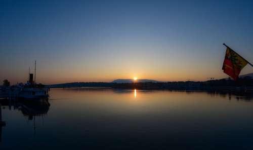 Sunrise Lake Reflection Boat Flag Calm Aurora