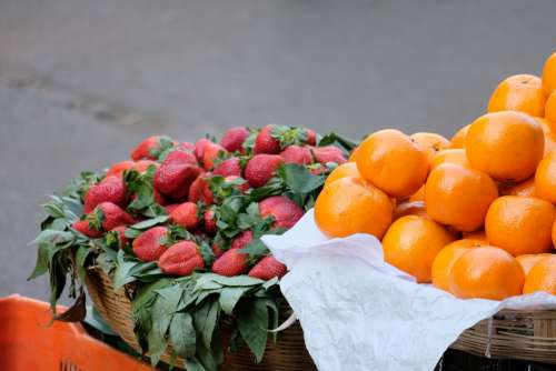 Strawberries and Oranges for Sale in Baskets