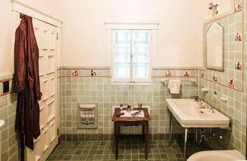 A Silk Robe Draped Over A Bathroom Door Photo