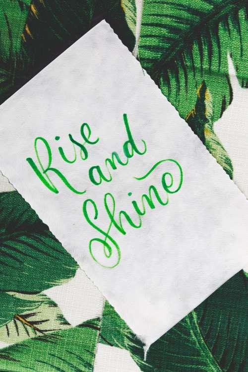 Cursive Handwriting With 'Rise And Shine' Photo