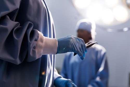 Doctor Holding Tweezers Photo