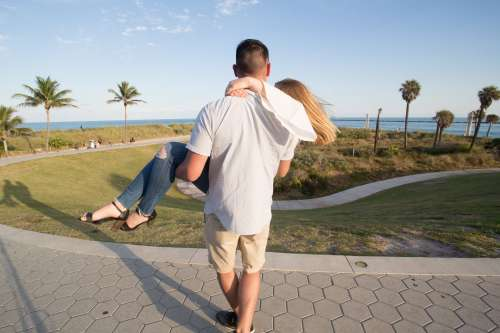 Man Carries Woman In Park Photo