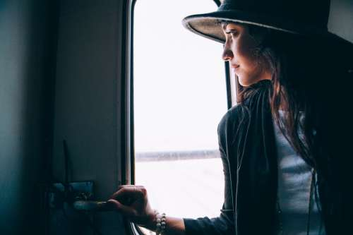 Woman Looks Out Train Window Photo