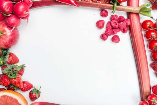 Red fruit and vegetables on a white background