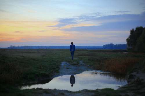 Man standing in front of a Puddle