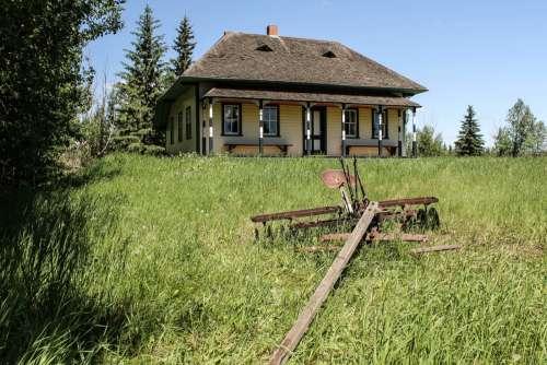 Old homestead and tiller