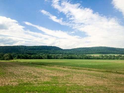 Landscape Over Blue Sky