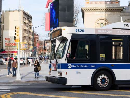 New York City Sidewalk and Bus
