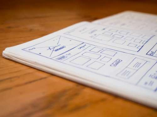 Sketchbook on Wooden Desk