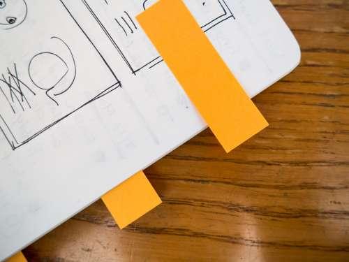 Sketchbook on Desk with Notes