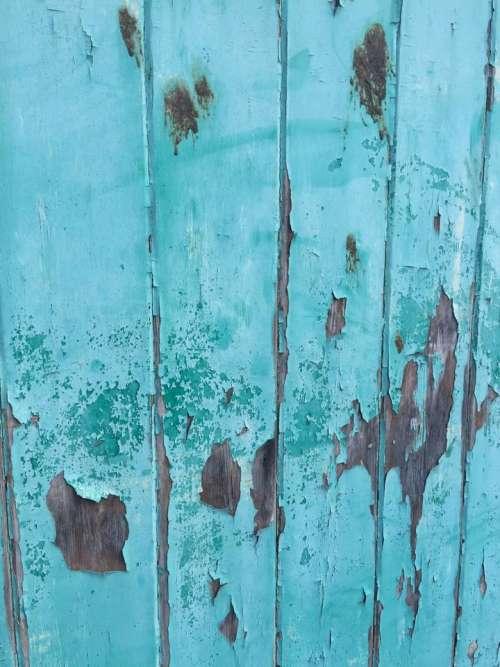 Turquoise flakey paint wooden door background