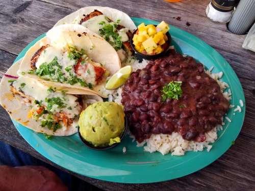 fish tacos quacamole mango salsa black beans and rice meal