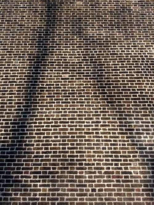 wall bricks house shadows sunlight