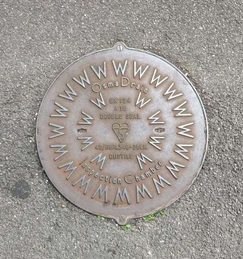 manhole cover drain road iron steel