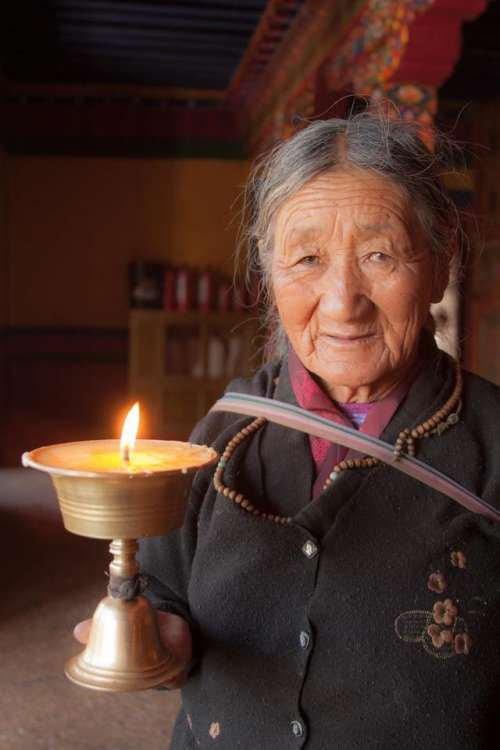 portrait woman Tibetan woman candle sacred