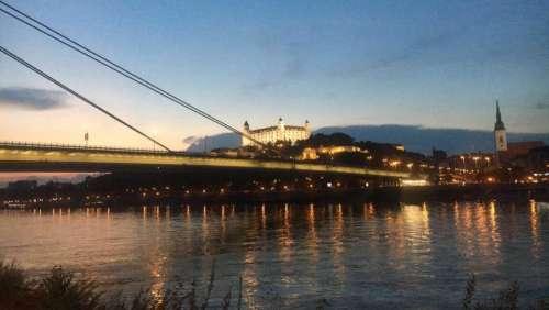 bridge river nighttime Europe