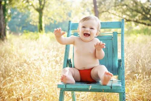 Baby Sitting Smiling Happy Boy Outdoor Blue Chair