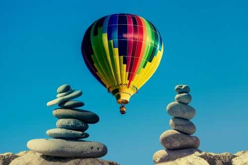 Balloon Stones Sky Balance Ease Serious Wellness