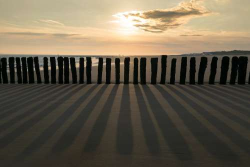 Groynes Sunrise Sea Sand Coast Sky Nature