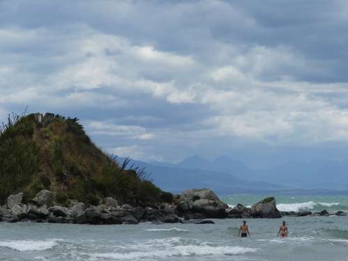Island Sea Moody Swimmers Mountains Blue Water