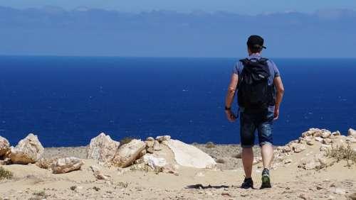 Man Hiking Backpack Sea Ocean Blue Rock