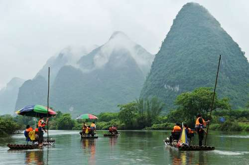 River Mountains Clouds Haze Rafts Bamboo Pole